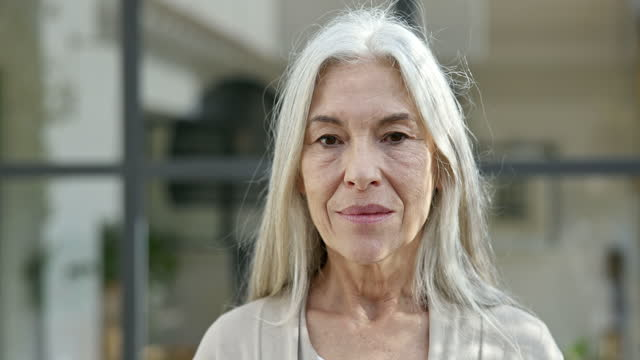 outdoor portrait of mid 60s woman with long gray hair - grey hair stock videos & royalty-free footage