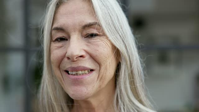outdoor portrait of senior woman - grey hair stock videos & royalty-free footage