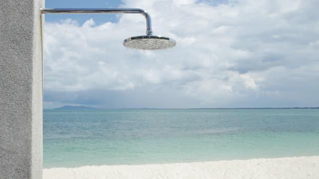 ms outdoor shower on beach / nikkoi island, bintan, indonesia - tourist resort stock videos & royalty-free footage