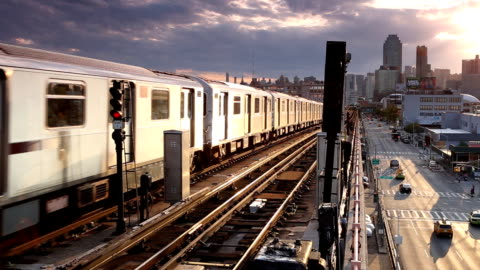 outdoor subway cityscape in queens - elevated train stock videos & royalty-free footage
