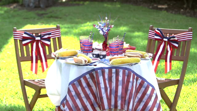 Outdoor table, chairs with red, white, blue decorations