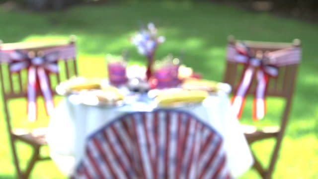 outdoor table, chairs with red, white, blue decorations - picnic table stock videos and b-roll footage