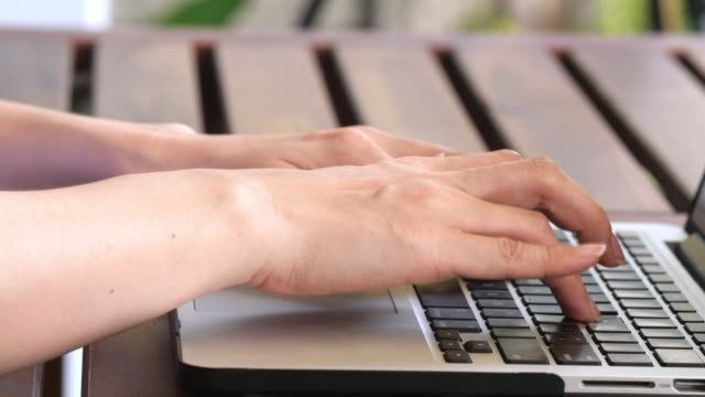 Outdoor : Typing On Notebook