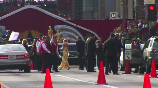 outdoors at the hollywood boulevard entrance to the academy awards, limos bring the beautiful guests in gowns to the most famous red carpet... - リムジン点の映像素材/bロール