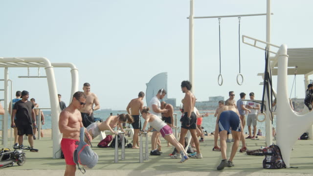 outdoors barcelona beach gym. people exercising workout - bodyweight training stock videos & royalty-free footage