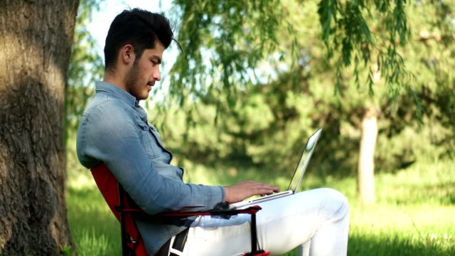 outdoors using laptop - personal computer video stock e b–roll