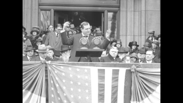 vídeos de stock, filmes e b-roll de outgoing governor ephraim f morgan standing at podium on stage introducing incoming governor howard gore with officials sitting on stage behind him... - viva gore