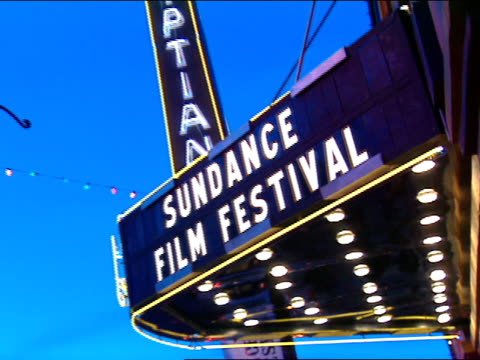 stockvideo's en b-roll-footage met dusk * out/in focus on sun film fes letter lights reflection in window next to theater pan zo sundance film festival lettering on egyptian theater... - sundance film festival
