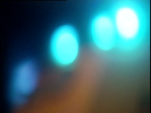 Out-of-focus blue lights on top of ambulance UK