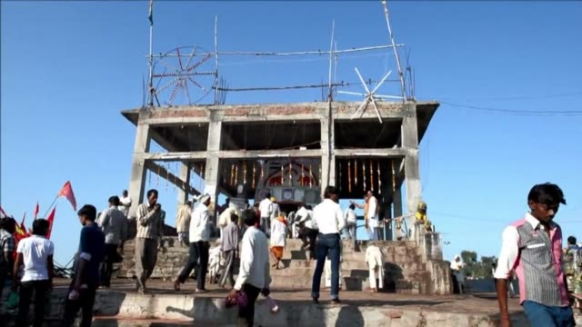 stockvideo's en b-roll-footage met outrage mounted in india after at least 115 devotees were crushed to death or drowned near a hindu temple the site of another deadly stampede only... - op hol slaan