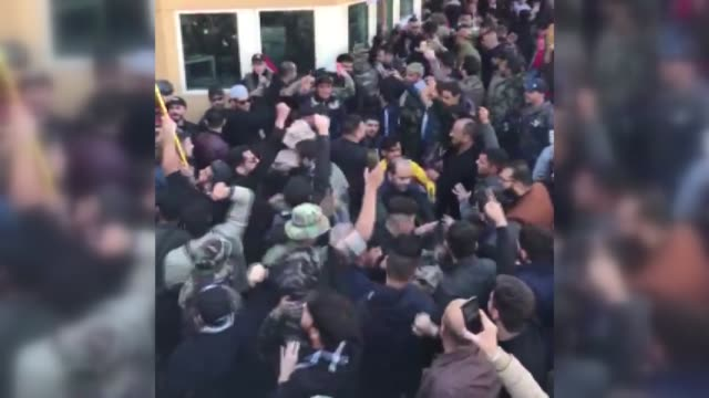 outraged iraqi protesters on tuesday stormed the u.s. embassy compound in baghdad, protesting washington's attacks on armed battalions belong to... - iraq stock videos & royalty-free footage