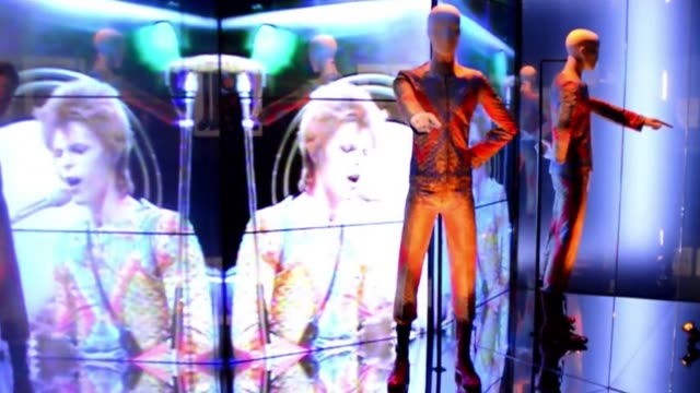 outrageous costumes and hand-scrawled lyrics are among hundreds of items going on show in a major london retrospective tracing david bowie relentless... - shock tactics stock videos & royalty-free footage