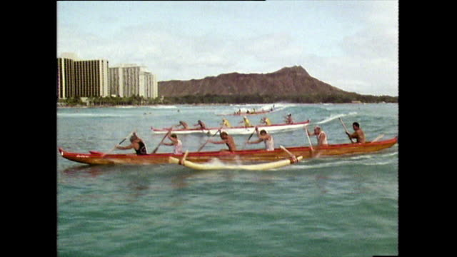 outrigger canoe team ride a wave at waikiki; 1983 - semi dress stock videos & royalty-free footage