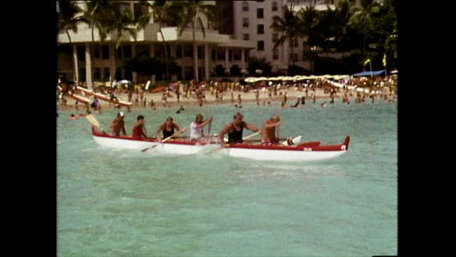 stockvideo's en b-roll-footage met outrigger canoes compete in race off waikiki coast; 1983 - startvlag
