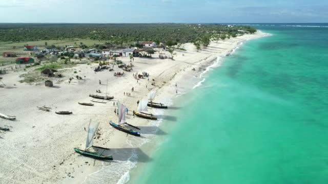 outrigger canoes on ambola beach, madagascar - madagaskar stock-videos und b-roll-filmmaterial