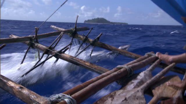 Outrigger of canoe as it sails on Pacific Ocean, Anuta, Solomon Islands