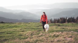 Outsanding mountain view and hiker with her dog