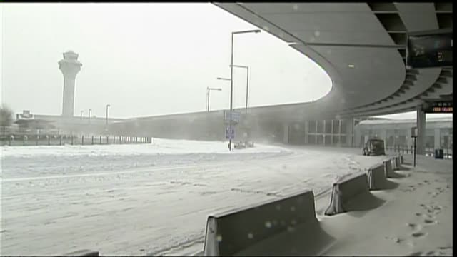 wgn outside a snowcovered o'hare airport during chicago's 2011 blizzard on february 2 2011 - o'hare airport stock videos & royalty-free footage