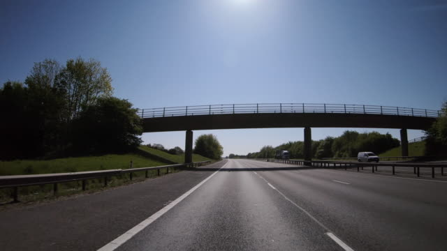 outside car point of view driving along the m40 motorway during lockdown, england, united kingdom - point of view stock videos & royalty-free footage