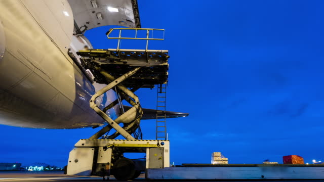 outside cargo plane loading with twilight sky - time lapse - cargo container stock videos & royalty-free footage