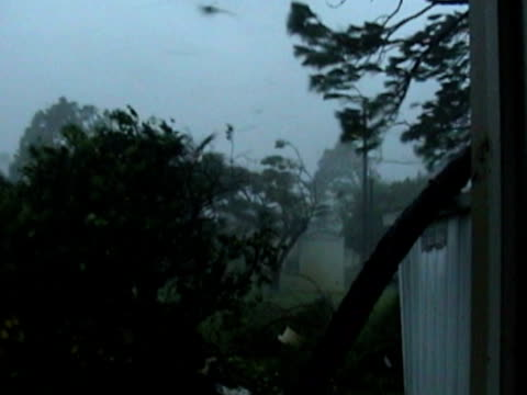 Outside during a Category-4 hurricane with flying debris.