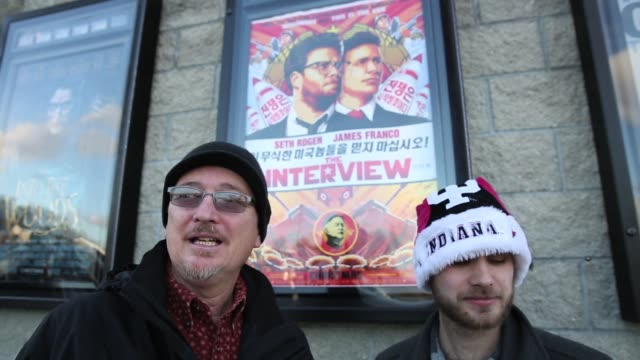 """outside jasper 8 theatres american movie goers talk about """"the interview,"""" which sony originally pulled after north korea allegedly hacked into the... - sony stock-videos und b-roll-filmmaterial"""