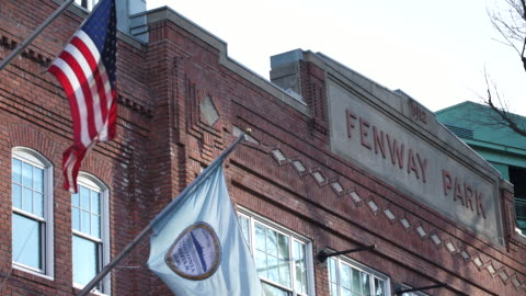 outside of fenway park with flags waving - boston massachusetts stock videos & royalty-free footage