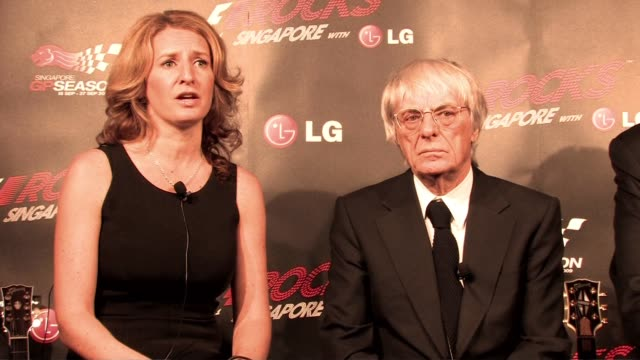 outside organisation of 'all the worlds' becky morgan and bernie ecclestone at the f1 rocks launch at london england. - bernie ecclestone stock videos & royalty-free footage