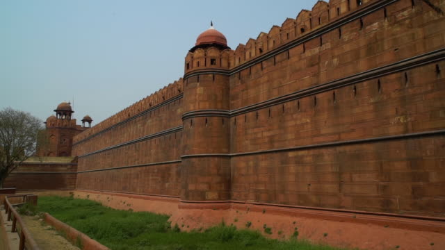 outside red wall of the  red fort, lal qila. - mughal empire stock videos and b-roll footage