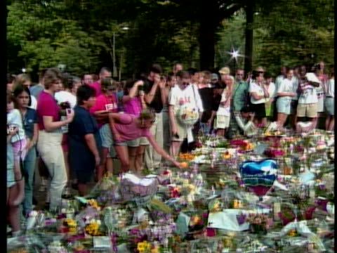 outside the british embassy there is a crowd standing next to the floral tribute to princess diana. princess diana died in a car crash in the pont de... - group of people stock videos & royalty-free footage