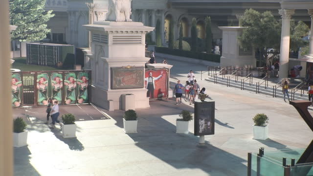 outside the caesars palace hotel and casino in las vegas, nevada, u.s., on sunday, july 26, 2020. caesars entertainment inc. is scheduled to release... - male likeness stock videos & royalty-free footage