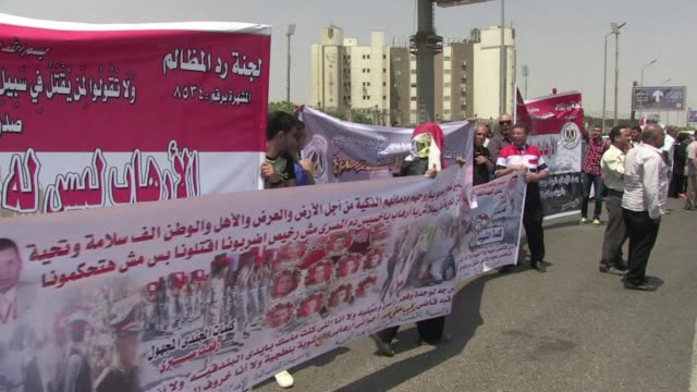 outside the mosque where the funeral of state prosecutor hisham barakat was held a crowd of 50 protesters chanted the people demand the execution of... - prosecutor stock videos & royalty-free footage