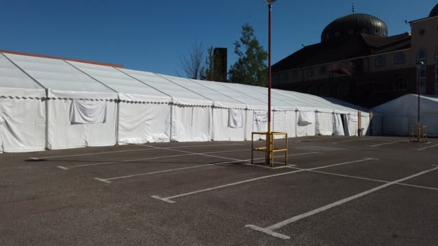 outside the tent of a temporary mortuary where caskets are stored is erected in the car park of central jamia mosque ghamkol sharif during the... - spirituality stock videos & royalty-free footage