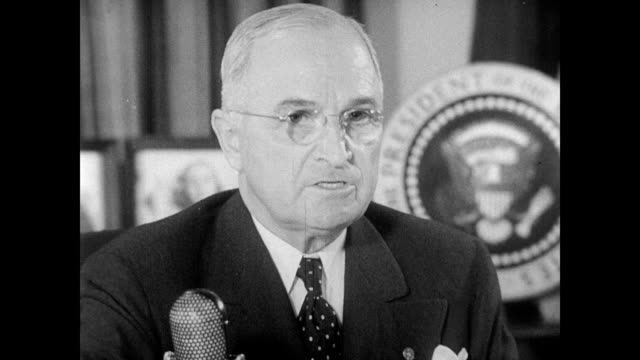outside the white house / president harry s truman seated at his desk in the oval office / cameramen behind huge film cameras / truman speaking to... - harry truman stock videos & royalty-free footage