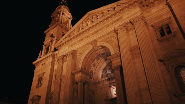 outside view of st. stephen basilica in budapest during the evening with artificial lighting - eastern european culture stock videos & royalty-free footage