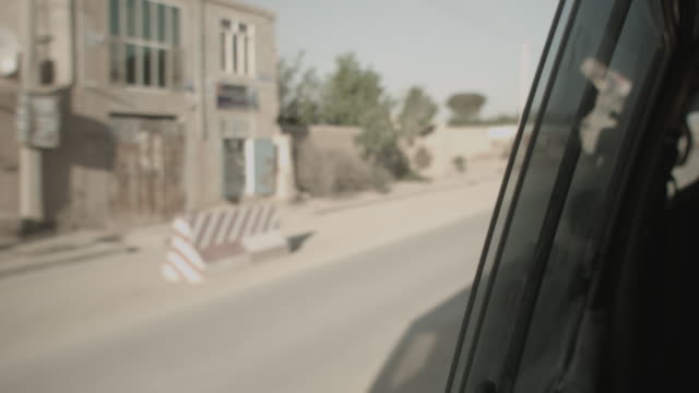 outskirt of herat, afghanistan, viewpoint from a moving vehicle - afghanistan stock videos & royalty-free footage
