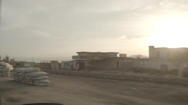 outskirt of herat, afghanistan, viewpoint from a moving vehicle - sack stock videos & royalty-free footage
