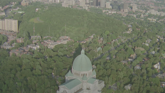d/x outskirts of montreal featuring old cathedral - montréal stock videos & royalty-free footage