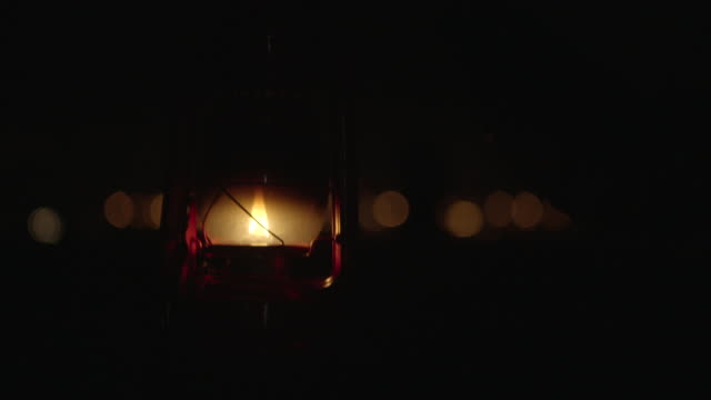 outstretched arm carries lantern - lantern stock videos & royalty-free footage