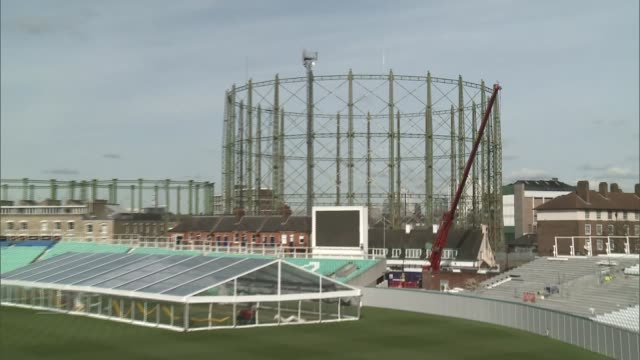 oval gasholder given protected status; england: london: kennington: the oval: ext graphicised pictures view of gasholder number 1 as it overlooks the... - oval kennington stock videos & royalty-free footage