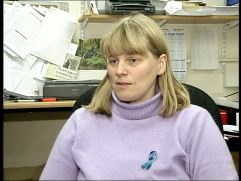 Ovarian cancer increase ITN Ruth Payne sitting talking on phone at desk Ruth Payne interviewed SOT Symptoms can be very diverse Female patient...