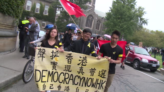 over 1,000 students gathered at university of toronto to voice their support for protesters in hong kong. - 2014 stock-videos und b-roll-filmmaterial