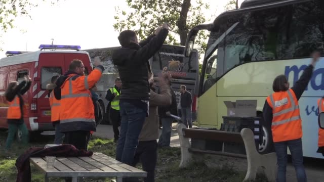 over 1,600 unaccompanied minors left in calais after the demolition of the infamous jungle migrant camp were bussed to shelters across france on... - infamous stock videos & royalty-free footage