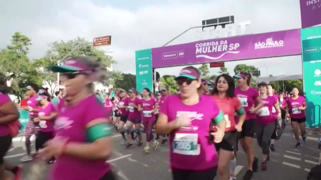 over 16000 women take part in a race in sao paulo to mark international womens day as screening trucks are set up to offer free mammograms and breast... - scientific imaging technique stock videos & royalty-free footage