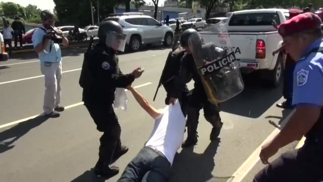 stockvideo's en b-roll-footage met over 20 protesters are arrested in managua nicaragua for demonstrating against the government of president daniel ortega - managua