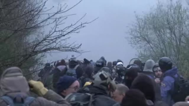 over 2,000 french police officers took part monday in the expulsion of the last holdouts from an anti capitalist camp at the site of an abandoned... - nantes stock videos & royalty-free footage