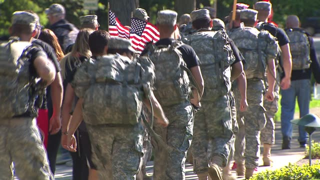 over 250 veterans and supporters walked from suburban glencoe to the uss memorial at chicago's navy pier to raise awareness for the epidemic of... - suicide stock videos & royalty-free footage