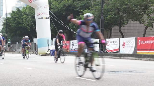 over 2500 international and local cyclists pedal through landmarks of hong kong including tsing ma bridge ting kau bridge and stonecutters bridge... - cycling event stock videos & royalty-free footage