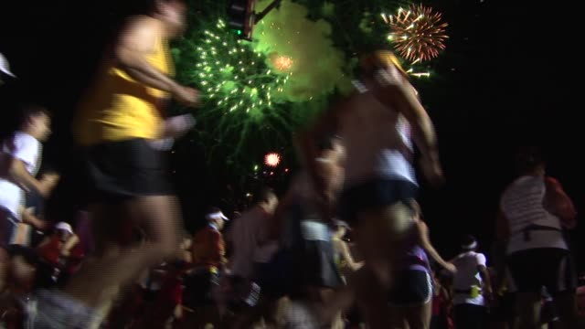 over 25000 runners take on 262 miles with a predawn start with festive entertainment start from ground level fireworks - salmini stock videos and b-roll footage