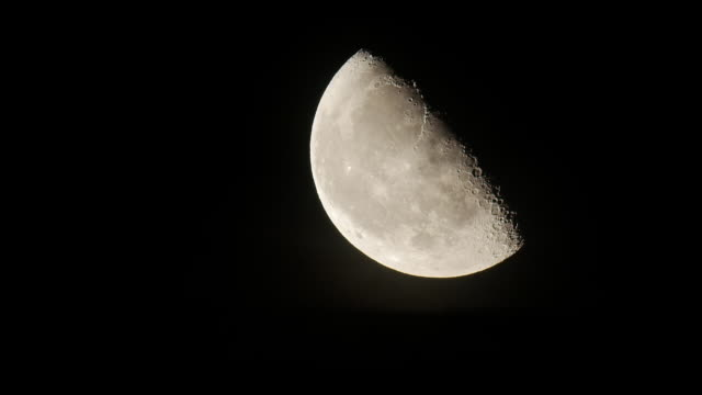 over 30 seconds long of half full moon rising at normal speed - 30 seconds or greater stock-videos und b-roll-filmmaterial